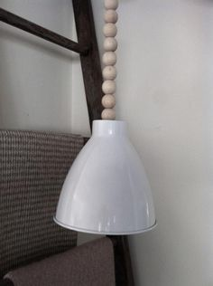 BRILLIANT! Hide cords on DIY pendant lights! <3 <3 <3 this!  DIY: Lamp Cord of Wooden Beads  Unlimited colors and possibilities, Oh I need 3 over the bar so glad hubby can handle the electrical part.  IKEA here I come.  Hiss....goes the spray paint.