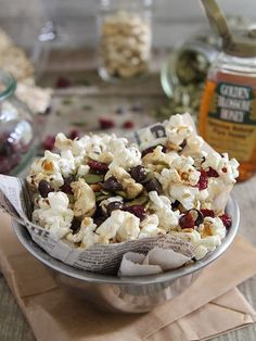 This trail mix popcorn is filled with nuts, seeds, dried fruit and chocolate chips for a fun snack.