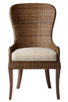 Wicker frames are most commonly found on dining chairs meant for patio use, but the durable material can reach into the upper levels of luxury, depending on build quality and style. Our featured example showcases a hybrid wood and wicker design, with an upholstered cushion seat.