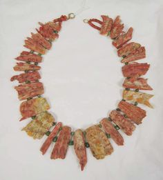 Necklace  Date:     2300 B.C.–A.D. 1492 Culture:     Indigenous American (Pre-Columbian) Medium:     coral, turquoise, cotton
