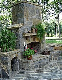 outdoor slate fireplace — this is pretty! Wonder if I could build an outdoor fireplace….