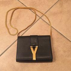 YSL crossbody bag Black YSL crossbody. Only worn twice. Has gold chain strap and gold tone Y closure Saint Laurent Bags Crossbody Bags