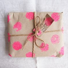 For when out of wrapping paper (me every day of my life)-- wrap in cardboard paper or any other type of random paper that you can find and decorate with contrasting homemade stamps-- it amps up the cuteness factor instantly!