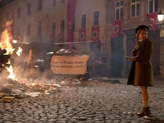 The setting for this is Hitler's birthday on the street where the parade was and where the book burning was taking place. This is important because this is where the book thief stole her second book. Sad Movies, I Movie, Book Burning, Australian Authors, War Film, The Book Thief, Into The Fire, History Online, Little Girls