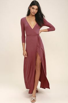 Stroll along tree-lined lanes, with a glass of ice tea and the Garden District Rusty Rose Wrap Maxi Dress flowing in the breeze! Lightweight jersey knit forms this three-quarter sleeve stunner with a wrapping surplice bodice, and tying sash at the waist. Wrapped detail carries into a front slit maxi skirt for a sensational finish.