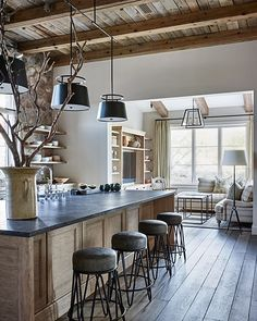 Absolutely love this kitchen design by #DavidMichaelMillerAssociates. The mixture of wood, stone & white is so calm & inviting!
