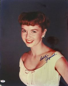 This is a 16x20 Photo that has been hand signed by Debbie Reynolds. The autograph has been certified authentic by PSA/DNA and comes with their sticker and matching full page certificate of authentici
