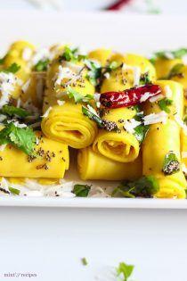 Khandvi is a popular Gujarati dish. It's very delicious in taste. Gujarati Recipes, Indian Food Recipes, Vegetarian Recipes, Ethnic Recipes, Gujarati Food, Khandvi Recipe, Appetizer Recipes, Dinner Recipes
