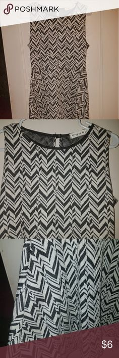Black and White Skater Dress Never worn, super cute. Dress up with heels or down with sneakers. Flares out a but at bottom so you could wear with leggings in the fall. Dresses Midi