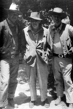 John Wayne, director John Ford, and Ward Bond.
