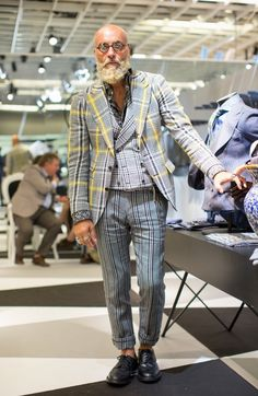 Taan says: A real gentleman looking man totally pulling of his grey striped casual chic avant-garde  look