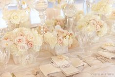Centerpieces similar to this in color.  Minus the orchids, add silver dusty miller.