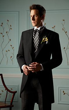 Grooms Tux - Style Romantic - Black & White Color Scheme.Just need a red tie. A daisy or carnation corsage.