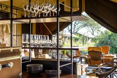 Designed for private use, the camp accommodates a maximum of six tented suites catering for families or friends, and is pitched and set up based on the requirements of each booking. The full staff complement includes a private Field Guide, chef and host, ensuring that activities, game drives and mealtimes can be arranged entirely according to guests' preference. Safari Adventure, Luxury Tents, Stay The Night, Tent Camping, Contemporary, Modern, Ceiling Lights, Explore, Field Guide