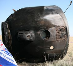 Soyuz capsule after touchdown on land.  About half the time they fall over thanks to the parachute!  Crew inside was OK.