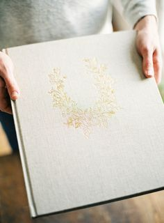 24K Gold Tooling | Custom Gold Wreath of Roses embossed onto the large 12x14 Neve Album | Heirloom Bindery Fine Art Books and Albums for Photographers and Artists
