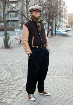 """""""My style is inspired by locking dance. Now I'm wearing a more neat version of a locking outfit. The big apple hat originates from the 70s and the wide pants are inspired by 40s zoot suits.I've bought my clothes in New York and Paris."""""""