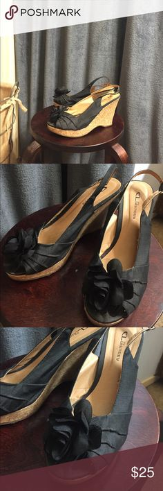 "Platform sandals Cute 4"" heels black with a flower on the front. These she have only been worn twice. Their in very good condition. Shoes Platforms"
