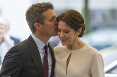 Stealing a kiss: Crown Prince Frederik was pictured kissing wife Crown Princess Mary durin...