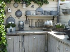 """self-built outdoor kitchen with concrete countertops and scaffolding wooden doors."""" By - via Welke Build Outdoor Kitchen, Outdoor Kitchen Design, Outdoor Cooking, Outdoor Rooms, Outdoor Gardens, Outdoor Living, Outdoor Kitchens, Rustic Kitchen, Vintage Kitchen"""