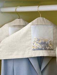 Linen hanger covers filled with chamomile and lavender are almost too pretty and sweet-smelling to relegate to a clothes closet, but they'll take good care of your favorites there. A sachet filled with chamomile and lavender adds a lovely scent Sewing Tutorials, Sewing Hacks, Sewing Crafts, Sewing Projects, Smocked Baby Dresses, Chevron Friendship Bracelets, Padded Hangers, Macrame Plant Hangers, Sewing Accessories