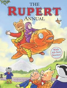 Rupert Annual 2009. shows Rupert riding in a 'Fish-Plane' with pilot. No.74. Written and illustrated by Stuart Trotter.
