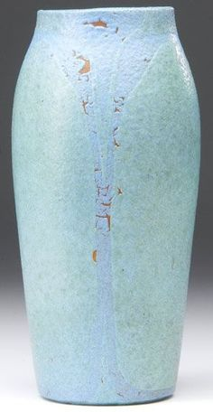 A Zark pottery ovoid vase having two layers of glaze as leaves and stems in green and lavender