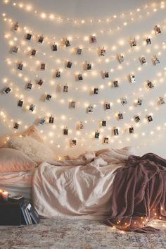 Dorm room decor - attach Instagram photos to a string of lights with clothespins
