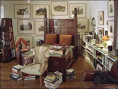 A Victorian oak bed, from Turbulence, served as both makeshift bookshelf and tie rack. The animal prints are by Audubon, and Avedon's 1972 portrait of Oscar Levant dominates a wall of pictures of women by various photographers. On the right is one of the small cactus lamps that Avedon liked to collect.    (Richard Avedon's apartment)