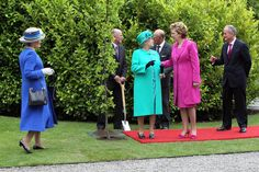 Queen Elizabeth II speaks with President Mary Mc Aleese after planting a tree at ceremony in Aras An Uachtarain while on the first day of her State Visit on May 17, 2011 in Dublin,Ireland. The Queen's visit, accompanied by The Duke of Edinburgh, is the first by a monarch since 1911. An unprecedented security operation is taking place with much of the centre of Dublin turning into a car free zone. Republican dissident groups have made it clear they are intent on disrupting proceedings.