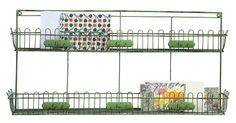 """http://www.homedecorators.com/P/Varden_Wall_Shelf/610/ Featuring two separate shelves with trellis trim, our iron Varden Wall Shelf gives you plenty of storage space. Hang this stylish green wall shelf in your kitchen, bathroom or home office for a touch of cheerful color and extra storage. Made of galvanized iron wire. Distressed green finish. Top shelf is 2""""D. Bottom shelf is 3.75""""D. Each shelf holds 11 pounds."""