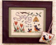 Brittercup Designs Spring is in the Air - Cross Stitch Pattern. Framed model stitched over 2 on 28 count Lambswool Linen and Scissor Fob stitched over 2 on 32 c