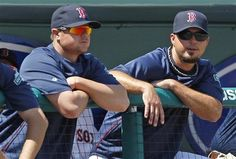 Boston Red Sox pitchers Josh Beckett, right, and Jon Leste watch from the dugout rail during the third inning of a spring training baseball game against the Minnesota Twins in Fort Myers, Fla., Monday, March 19, 2012. Red Sox manager Bobby Valentine named Lester as the Opening Day starter, with Beckett lining up in the rotation to take the mound in the home opener at Fenway Park.