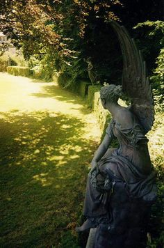 Kilruddery, statuary by Ilkhanid.  What could she be looking for...or waiting on....or maybe hearing....?