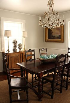 The wall color is Benjamin Moore's Halo OC-46 in eggshell.    The trim and wainscoting is BM White Dove in Latex Satin Impervo.  Here the White Dove looks a little gray and not warm