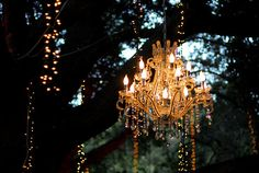 I never thought to hang these chandeliers from trees outside. So pretty. #GElighting