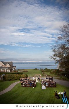 The Black Point Inn,  Prouts Neck, Scarborough, just outside of Portland, Maine, is a lovely site for a wedding. In all seasons.  The historic Maine Inn is a gracious setting with deep porches that face the water, a traditional dining room that is spacious enough to accommodate dinner and dancing, and a welcoming lobby (with a fireplace and multiple seating areas) for guests who spill out of the main reception room.  Photo by Michele Stapleton of www.MaineWeddingPhotographer.com…