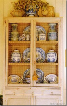 Blue and white china...my fav. I would love a pantry like this. I've thought about refurb-ing my old boring hutch with chicken wire and paint. This just might make me do it. ~bzb