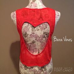✨Boutique Tank Top✨ Tank top in a striking coral color. The back has a cut out heart. Adorable with jeans!                     Size: Small.       No trades Tops Tank Tops