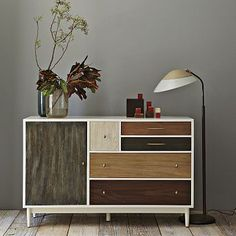 Take this uber cool patchwork wood stain dresser from WestElm and apply it to any dresser with clean lines that you can find at a thriftsore or garage sale etc.!!  If the wood the dresser is made of is not the real stainable kind- there are wood veneers of all colors you can buy and glue on to the dresser face!! [Patchwork Dresser #WestElm]