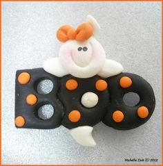 Polymer Clay Bow Center Embelishment Boo Ghost Black and Orange NO Hole. $3.25, via Etsy.