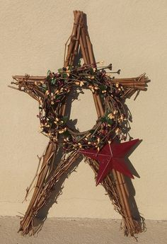 One of my customers shared this wreath that they made with items from our store.  1 - primitive grapevine star  1 - 4 inch berry ring (assorted colors available)  1 - 5 inch riveted barn star (assorted colors available)    The whole thing is tied together with our rusty craft wire.  Looks Great! Make one to match your decor or the season!  http://www.outerbankscountrystore.com/