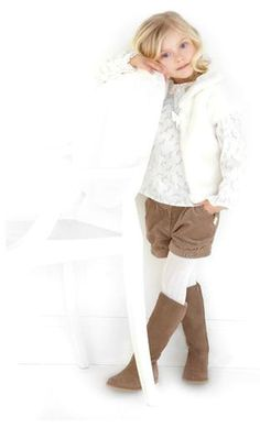 Tartine et Chocolat kids clothing fall lineup. Corduroy shorts over white leggings and boots