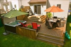 come down a couple steps and then deck... hot tub is a nice add on..