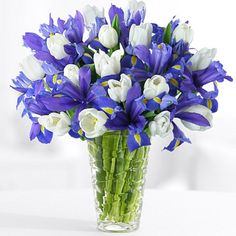 In this arrangement, it's form and it includes purple iris, white tulips. Iris Wedding Flowers, Wedding Flower Decorations, Iris Flowers, Wedding Flower Arrangements, All Flowers, Spring Flowers, Wedding Bouquets, Floral Arrangements, Beautiful Flowers