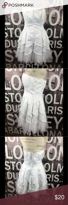 Steppin Out white fit flare strapless dress So fun and flirty. Excellent condition. No stains. Size 11/12 but runs small so please look at measurements. Length 26.5 Bust 16.5 Waist 15 Hips 23 Steppin Out Dresses Prom