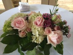 Centerpiece for spring wedding using roses and hydrangeas
