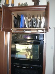 Upright Tray Storage  Above Double Oven, I had them add a shallow horizontal shelf to hold small serving dishes.  No use wasting good potential space!