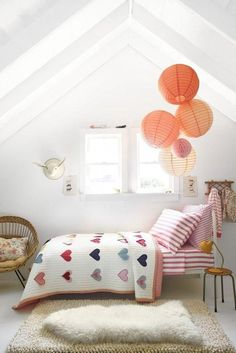 cutesy little girl room with dainty heart quilt, dreamy lanterns, and soft pink accents