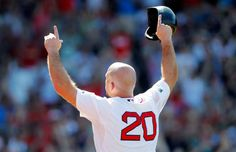 kevin youkilis salutes the fenway crowd as he leaves the field during his last game in a red sox uniform.